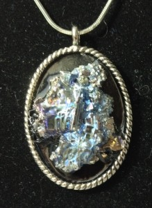 A bismuth crystal pendant.